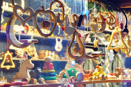 Close-up image of a stand with wooden toys and Christmas tree decorations at the Christmas Market in Old Riga, Latvia Archivio Fotografico