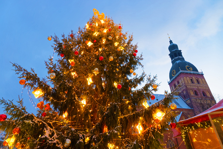 old towns: Christmas tree in Rigas Christmas market held at Old Towns Dome Square. Riga is thought to be the City where the tradition of decorating the Christmas Tree started