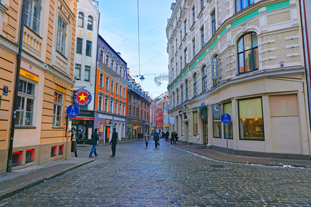 declared: RIGA, LATVIA - DECEMBER 28, 2014: Medieval street in old town of Riga city, Latvia. In 2014, Riga was declared as the European capital of culture.