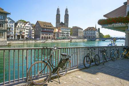 grossmunster cathedral: Zurich city center, Grossmunster, Bicycles and Limmat quay in summer, Switzerland Stock Photo