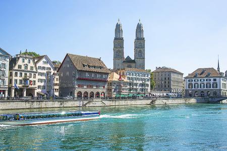 grossmunster cathedral: Zurich city center, Grossmunster and Limmat quay in summertime, Switzerland
