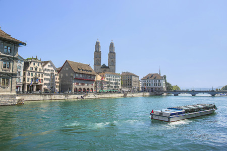 grossmunster cathedral: Zurich city center, Grossmunster and Limmat quay in summer, Switzerland Stock Photo