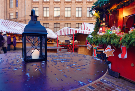 in europe: Lantern with a burning candle on a table at a traditional European Christmas market. Riga, Latvia