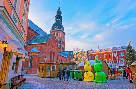 christmas atmosphere: RIGA, LATVIA - DECEMBER 28, 2014: Christmas atmosphere at the Dome square in Old Riga, Latvia