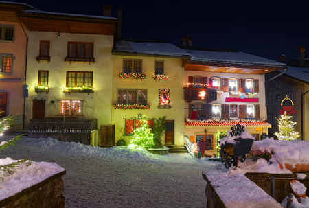 gruyere: Winter night scenery of the medieval town of Gruyeres, district of Gruyere, Fribourg canton, Switzerland Stock Photo