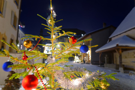 old buildings: Christmas fir tree in the street of the medieval town of Gruyeres, district of Gruyere, Fribourg canton, Switzerland Stock Photo