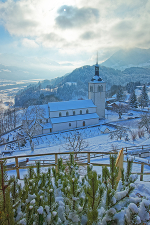 gruyere: View of the church near Gruyere castle in winter, Switzerland