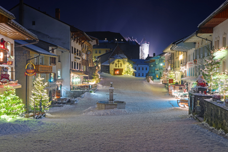Night view of the medieval town of Gruyeres, district of Gruyere, Fribourg canton, Switzerland