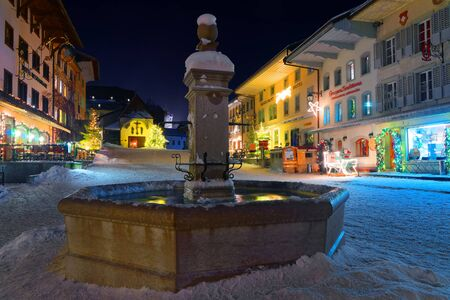 gruyere: Christmas illumination in the snowy streets of the medieval town of Gruyeres, district of Gruyere, Fribourg canton, Switzerland Editorial