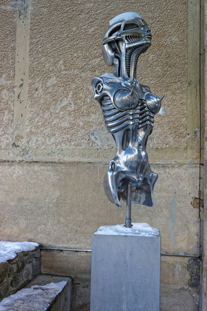 awarded: Metal statue of Alien in HR Giger Museum in Gruyere, Switzerland. HR Giger was the creator of all the artwork innvolving the movie Alien. Academy awarded by his work on this movie