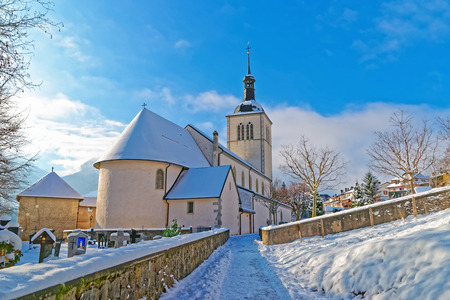 gruyere: View of the picturesque old church near Gruyere castle on a sunny winter day, Switzerland