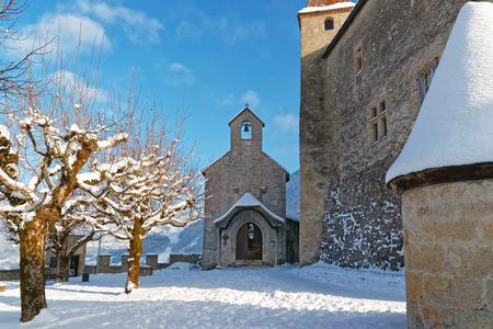 dinky: GRUYERE, SWITZERLAND - DECEMBER 31, 2014: Dinky little chapel near the castle of Gruyeres in Switzerland on a sunny winter day. Editorial