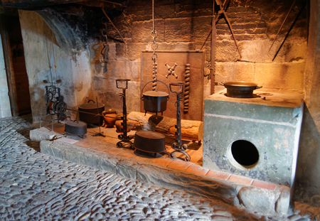 gruyere: GRUYERE, SWITZERLAND - DECEMBER 31, 2014: Exhibition of kitchen utensils held at the castle of Gruyeres in Switzerland.