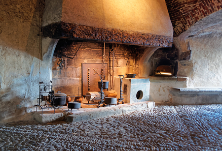 houseware: GRUYERE, SWITZERLAND - DECEMBER 31, 2014: Ancient houseware displayed in the castle of Gruyeres in Switzerland. It is a Swiss heritage site of national significance