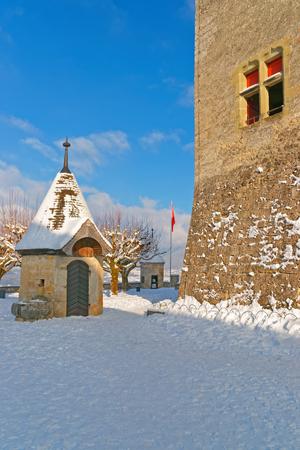 gruyere: GRUYERE, SWITZERLAND - DECEMBER 31, 2014: Esplanade in front of the Gruyere castle in Switzerland on a sunny winter day