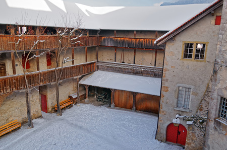 gruyere: GRUYERE, SWITZERLAND - DECEMBER 31, 2014: Homey looking inner courtyard of the castle of Gruyeres in Switzerland. Gruyere is a famous tourist destination and also known for its cheese