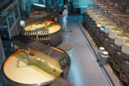 gruyere: GRUYERE, SWITZERLAND - DECEMBER 31, 2014: Processing area of the Maison du Gruyere, a famous cheese factory located in the medieval town of Gruyères in Switzerland. Editorial