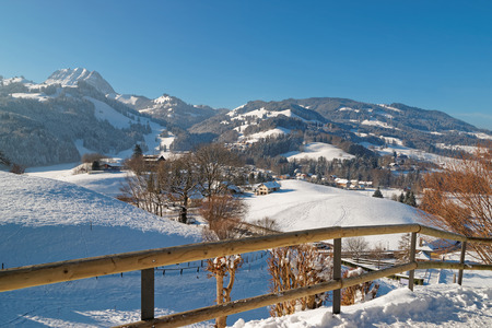 gruyere: Beautiful winter landscape of Swiss mountains. Region of Gruyere, province of Fribourg, Switzerland Editorial