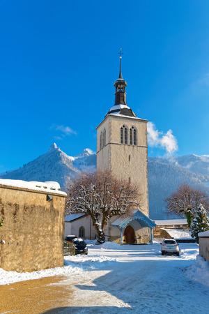 gruyere: View of the church of Saint Theodul near Gruyere castle on a sunny winter day, Switzerland