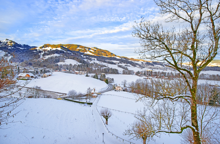 gruyere: Panoramic view of swiss mountains landscape on a sunny winter day. Region of Gruyere, province of Fribourg, Switzerland