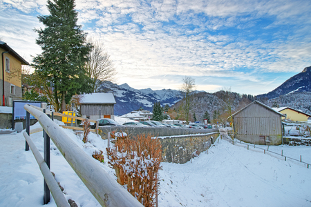 gruyere: Snow-covered town of Gruyeres in Switzerland, famous agricultural and Gruyere cheese making area, on a beautiful winter day