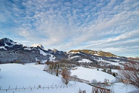 gruyere: Idyllic winter landscape of Swiss mountains. Region of Gruyere, province of Fribourg, Switzerland