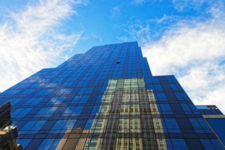 travel industry: Upward view of a modern glass and steel office buildings in New York City, USA Stock Photo