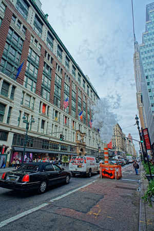macys: NEW YORK, USA - MAY 06, 2015: Ambience of street life near a famous Macys Department store in Herald Square Manhattan. The building is listed on the National Register of Historic Places as a landmark Editorial
