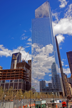 Construction site with blue sky and clouds reflection in windows of modern office building in New York City, USA Stock Photo
