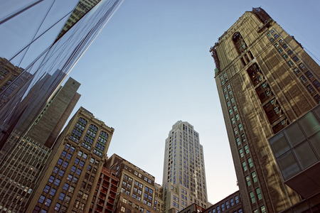 manhattan mirror new york: Modern glass skyscrapers under the blue sky in business district of NYC, USA