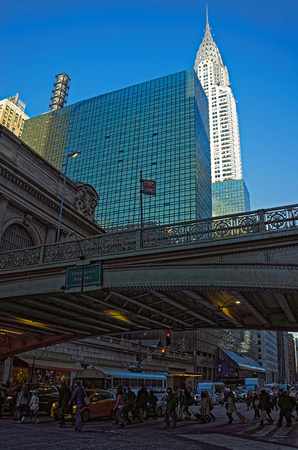 manhattan mirror new york: New York, USA - April 25, 2015: View of the bridge in front of Grand Central Terminal on 42nd street and the Chrysler skyscraper in the background. Midtown Manhattan, NYC, USA Editorial