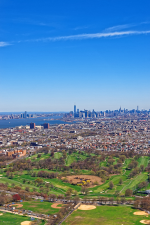 populous: Aerial view of downtown Brooklyn with Manhattan in the background and Prospect Park in the foreground. Brooklyn Prospect Park is an urban oasis in the middle of New York Citys most populous borough Stock Photo