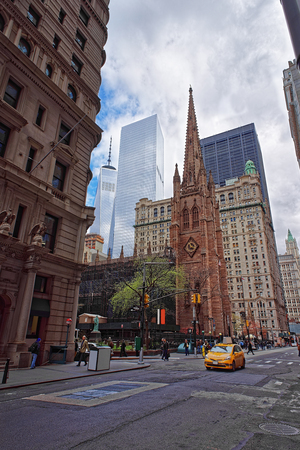 broadway tower: NEW YORK, USA - APRIL 24, 2015: Trinity Church at the intersection of Wall Street and Broadway in Manhattan and Freedom Tower visible in the background. NYC, USA