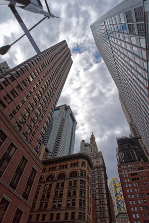 highrises: Low angle view of NYC skyscrapers. New York City skyscrapers are concentrated in Manhattan, although other neighborhoods of Manhattan and the boroughs of Brooklyn, Queens also have a few highrises