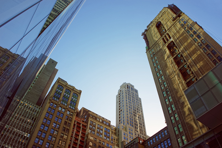 manhattan mirror new york: Modern glass skyscrapers under the clear blue sky in business district of New York, USA
