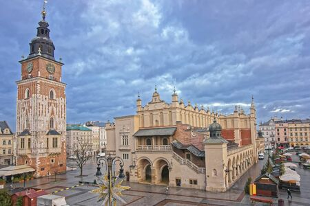 Town Hall Tower and Cloth hall in the Main Market Square of the Old City in Krakow in Poland at Christmas