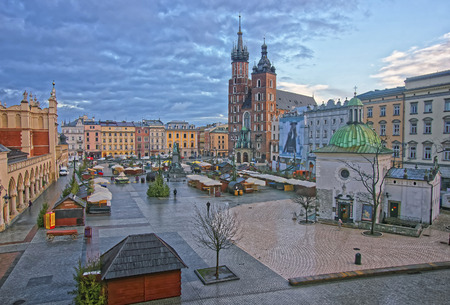 St Mary Basilica and Church of St Wojciech and Cloth Hall in the Main Market Square of the Old City in Krakow in Poland at Christmas time Editorial
