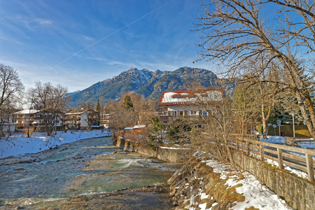 chalets: Beautiful landscape of Bavarian Village Garmisch-Partenkirchen (Germany), city of the winter olympics in 1936, with stunning mountain scenery and idyllic little Alpine chalets