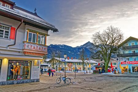 zugspitze mountain: GARMISCH-PARTENKIRCHEN, GERMANY - JANUARY 06, 2015: View of the street in Garmisch-Partenkirchen, an idyllic mountain resort in the valleys of the Bavarian Alps beneath the towering Zugspitze peak