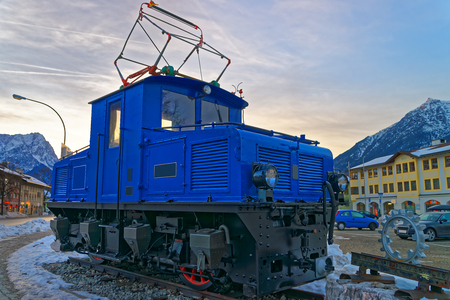 zugspitze mountain: Discarded electric cog locomotive of the Bavarian Zugspitze Cog Railway back on the base of the mountain in Garmisch-Partenkirchen. Bavaria. Germany
