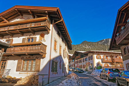 zugspitze mountain: Enchanting Bavarian-styled houses in Garmisch-Partenkirchen beautifully adorned with painted scenes. It is a mountain resort in the valleys of the Bavarian Alps beneath the towering Zugspitze peak