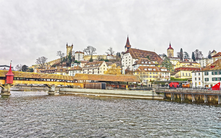 the medieval: Cityscape of Lucerne with Chapel bridge, embankment and the city wall tower on the background. Switzerland. Europe.