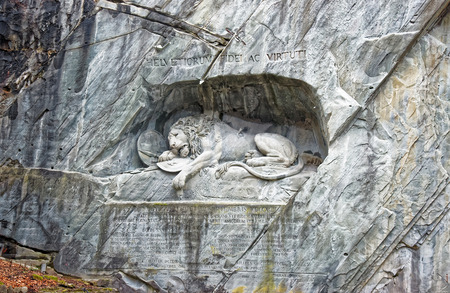 stormed: Dying Lion monument, a sculpture in Lucerne (Switzerland) carved in the rock to honor Swiss Guards who were massacred during the French Revolution when revolutionaries stormed the Tuileries Palace