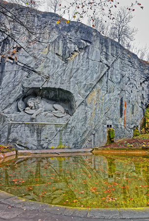 stormed: Dying Lion or Lion of Lucerne monument in Lucerne, Switzerland. Carved in the rock, it honors Swiss Guards, massacred during the French Revolution when revolutionaries stormed the Tuileries Palace