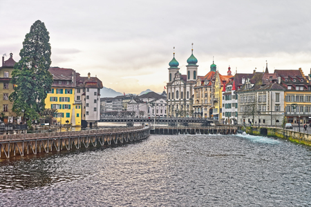 jesuit: Jesuit Church along the river Reuss in the old part of Lucerne, Switzerland. The Lucerne Jesuit Church is the first large baroque church built in Switzerland north of the Alps. Stock Photo