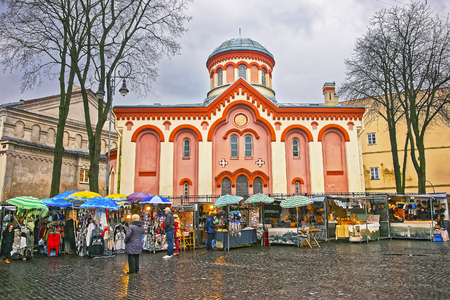 VILNIUS, LITHUANIA - JANUARY 2, 2012: Street market near Church of Saint Paraskeva in the Old Town of Vilnius in Lithuania