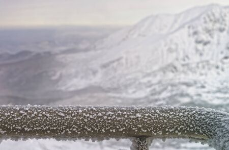 hand rail: Fragment of a Fence Rail being frozen in mountains in the winter time