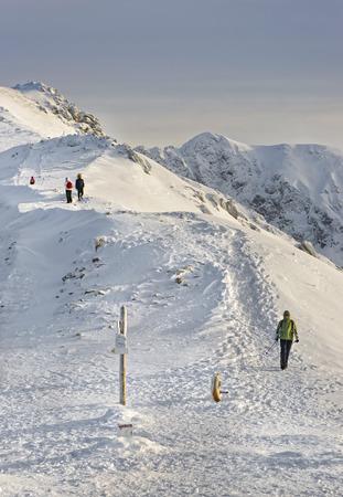 zakopane: People on the top of Kasprowy Wierch in Zakopane in Tatras in winter. Zakopane is a town in Poland in Tatra Mountains. Kasprowy Wierch is a mountain in Zakopane and the most popular ski area in Poland