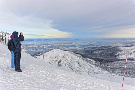 zakopane: ZAKOPANE, POLAND - JANUARY 8, 2015: People taking photos in Kasprowy Wierch in Zakopane in Tatra Mountains. Kasprowy Wierch is a mountain in Zakopane and is the most popular ski area in Poland