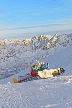 snowcat: Ratrack at work in Kasprowy Wierch in Zakopane in the winter time. Zakopane is a town in Poland in Tatra Mountains.Kasprowy Wierch is a mountain in Zakopane and the most popular ski area in Poland